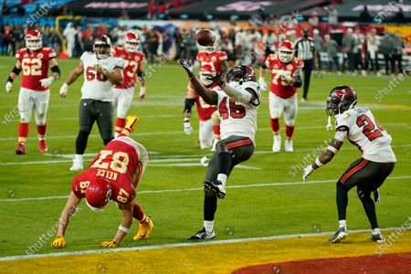 Tampa Bay Buccaneers inside linebacker Devin White makes an interception against Kansas City Chiefs tight end Travis Kelce during the second half of the NFL Super Bowl 55 football game, in Tampa, Fla