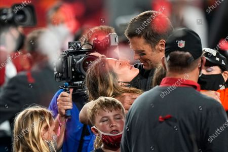 Tampa Bay Buccaneers quarterback Tom Brady celebrates with his wife Gisele Bundchen and children after the NFL Super Bowl 55 football game against the Kansas City Chiefs, in Tampa, Fla. The Buccaneers defeated the Chiefs 31-9 to win the Super Bowl