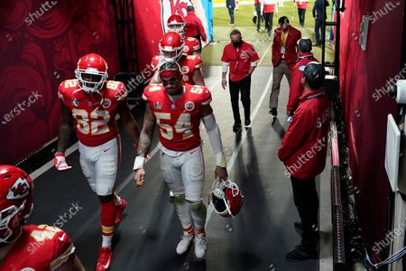 Kansas City Chiefs' Tyrann Mathieu (32) and Damien Wilson (54) walk to the locker room following of the NFL Super Bowl 55 football game, in Tampa, Fla. The Buccaneers defeated the Chiefs 31-9 to win the Super Bowl