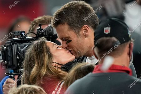 Tampa Bay Buccaneers quarterback Tom Brady kisses wife Gisele Bundchen after defeating the Kansas City Chiefs in the NFL Super Bowl 55 football game, in Tampa, Fla. The Buccaneers defeated the Chiefs 31-9 to win the Super Bowl