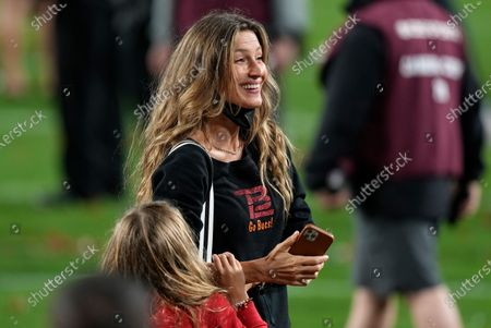Gisele Bundchen, wife of Tampa Bay Buccaneers quarterback Tom Brady smiles after the Tampa Bay Buccaneers defeated the Kansas City Chiefs in the NFL Super Bowl 55 football game, in Tampa, Fla. The Buccaneers defeated the Chiefs 31-9 to win the Super Bowl