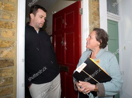 Susan Kramer talks with local resident Pete Reid.