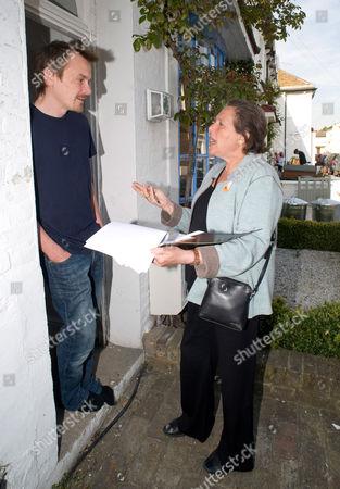 Susan Kramer talks with local resident Mr Thomas.