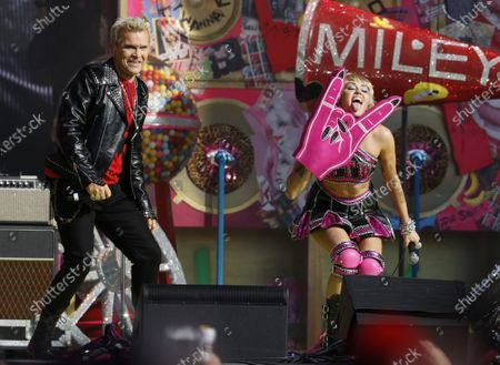 Billy Idol and Miley Cyrus perform during the Tic Tok Tailgate party