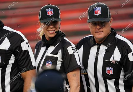 Sarah Thomas, a down judge and the first woman to officiate in a Super Bowl, stands on the field with line judge Rusty Baynes before the start of Super Bowl LV at Raymond James Stadium