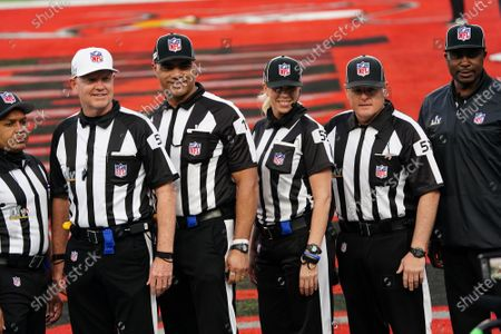 Stock Photo of Sarah Thomas, a down judge and the first woman to officiate in a Super Bowl, stands on the field with the other officials before the start of Super Bowl LV at Raymond James Stadium