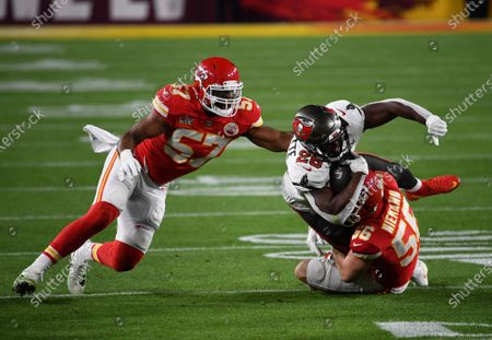 Tampa Bay Buccaneers Andrew Adams (26) is tackled by Kansas City Chiefs Ben Niemann (56) in the second quarter of Super Bowl LV at Raymond James Stadium
