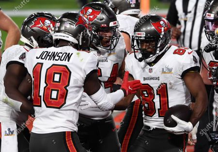 Tampa Bay Buccaneers Antonio Brown (81) is congratulated by teammates after scoring in the second quarter in Super Bowl LV against the Kansas City Chiefs at Raymond James Stadium