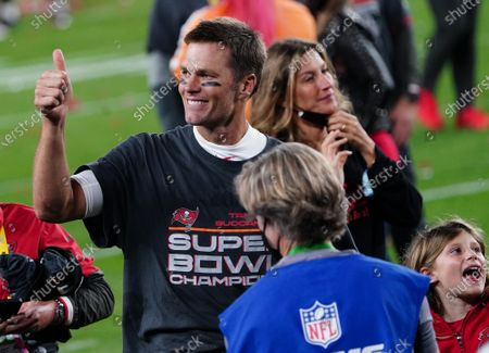 Tampa Bay Buccaneers quarterback Tom Brady leaves the field with his wife Gisele Bundchen and children after the Buccaneers defeated the Kansas City Chiefs 31-9 to win Super Bowl LV at Raymond James Stadium