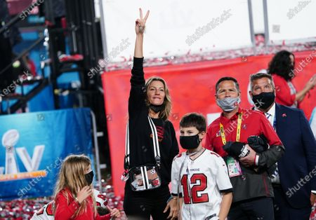 Tampa Bay Buccaneers quarterback Tom Brady's wife Gisele Bundchen waves as she and her children wait after the Buccaneers defeated the Kansas City Chiefs 31-9 to win Super Bowl LV at Raymond James Stadium