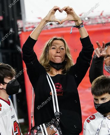 Tampa Bay Buccaneers quarterback Tom Brady's wife Gisele Bundchen makes a heart sign as she and her children wait after the Buccaneers defeated the Kansas City Chiefs 31-9 to win Super Bowl LV at Raymond James Stadium