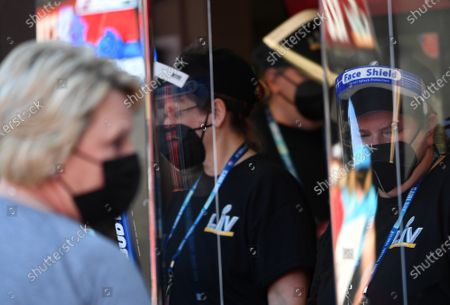 Stadium workers wear face shields due to COVID restrictions before the start of Super Bowl LV against the Kansas City Chiefs at Raymond James Stadium