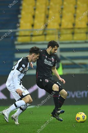 "Andrea Poli (Bologna)Dennis Man (Parma)              during the Italian ""Serie A  match between Parma 0-3 Bologna at  Ennio Tardini Stadium in Parma, Italy."