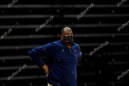 Georgetown's Patrick Ewing coaches during an NCAA college basketball game against Villanova, in Villanova, Pa