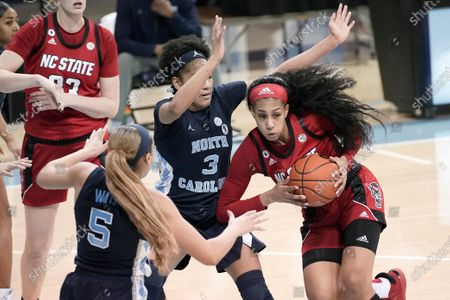 North Carolina State forward Jakia Brown-Turner drives while North Carolina guard Kennedy Todd-Williams (3) and guard Stephanie Watts (5) defend during the first half of an NCAA college basketball game in Chapel Hill, N.C