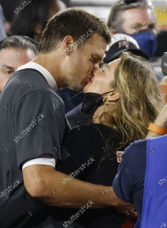 Tampa Bay Buccaneers quarterback Tom Brady kisses his wife Gisele Bundchen as he celebrates his Super Bowl LV victory over the Kansas City Chiefs at Raymond James Stadium