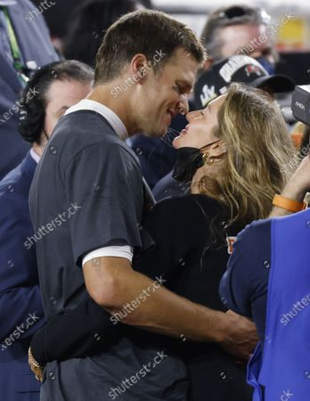 Tampa Bay Buccaneers quarterback Tom Brady is congratulated by his wife Gisele Bundchen as he celebrates the Buccaneers Super Bowl LV victory over the Kansas City Chiefs at Raymond James Stadium
