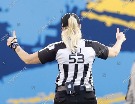 Stock Image of First Female Referee at the Super Bowl Sarah Thomas reacts on the sidelines prior to the start of Super Bowl LV at Raymond James Stadium in Tampa, Florida
