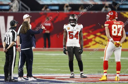 Tampa Bay Buccaneers Lavonte David (54) and Kansas City Chiefs Travis Kelce (87) watch the coin toss prior to the start of Super Bowl LV at Raymond James Stadium