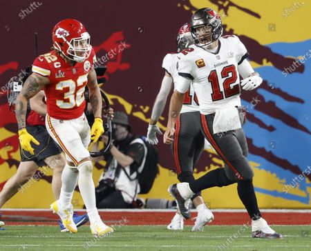 Stock Picture of Tampa Bay Buccaneers quarterback Tom Brady (12) exchanges words with Kansas City Chiefs Tyrann Mathieu (32) after a Tampa Bay touchdown in the second quarter of Super Bowl LV at Raymond James Stadium