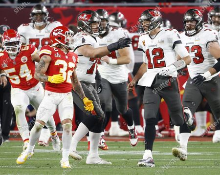 Tampa Bay Buccaneers quarterback Tom Brady (12) exchanges words with Kansas City Chiefs Tyrann Mathieu (32) after a Tampa Bay touchdown in the second quarter of Super Bowl LV at Raymond James Stadium