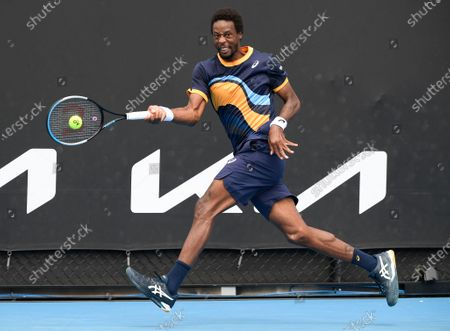 France's Gael Monfils makes a forehand return to Finland's Emil Ruusuvuori during their first round match at the Australian Open tennis championship in Melbourne, Australia