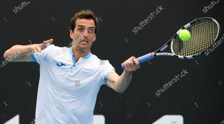 Spain's Albert Ramos-Vinolas makes a forehand return to United States' Taylor Fritz during their first round match at the Australian Open tennis championship in Melbourne, Australia