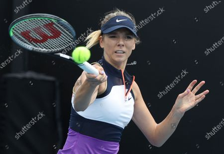 Britain's Katie Boulter makes a forehand return to Russia's Daria Kasatkina during their first round match at the Australian Open tennis championship in Melbourne, Australia
