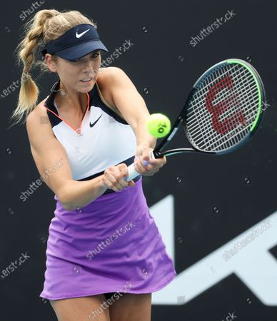 Britain's Katie Boulter makes a backhand return to Russia's Daria Kasatkina during their first round match at the Australian Open tennis championship in Melbourne, Australia
