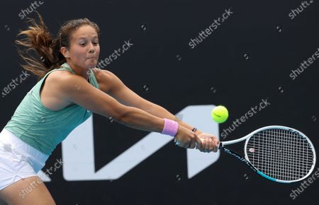 Russia's Daria Kasatkina makes a backhand return to Britain's Katie Boulter during their first round match at the Australian Open tennis championship in Melbourne, Australia