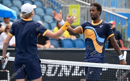 France's Gael Monfils, right, congratulates Finland's Emil Ruusuvuori after their first round match at the Australian Open tennis championship in Melbourne, Australia