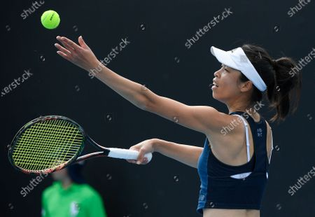 Stock Photo of Taiwan's Hsieh Su-Wei serves to Bulgaria's Tsvetana Pironkova during their first round match at the Australian Open tennis championship in Melbourne, Australia