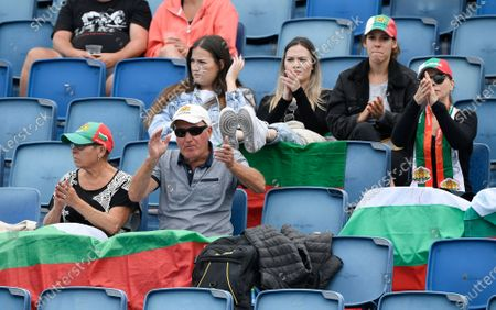 Bulgarian fans cheer Bulgaria's Tsvetana Pironkova during her first round match against Taiwan's Hsieh Su-Wei at the Australian Open tennis championship in Melbourne, Australia
