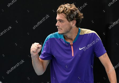 United States' Taylor Fritz reacts after winning a point against Spain's Albert Ramos-Vinolas during their first round match at the Australian Open tennis championship in Melbourne, Australia