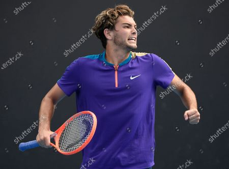 United States' Taylor Fritz celebrates after defeating Spain's Albert Ramos-Vinolas in their first round match at the Australian Open tennis championship in Melbourne, Australia