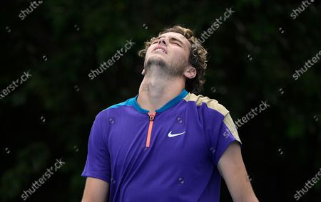 United States' Taylor Fritz reacts after defeating Spain's Albert Ramos-Vinolas in their first round match at the Australian Open tennis championship in Melbourne, Australia