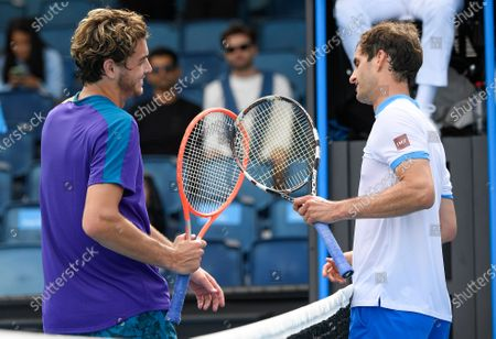 United States' Taylor Fritz, left, is congratulated by Spain's Albert Ramos-Vinolas after winning their first round match at the Australian Open tennis championship in Melbourne, Australia