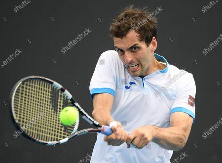 Spain's Albert Ramos-Vinolas makes a backhand return to United States' Taylor Fritz at the Australian Open tennis championship in Melbourne, Australia
