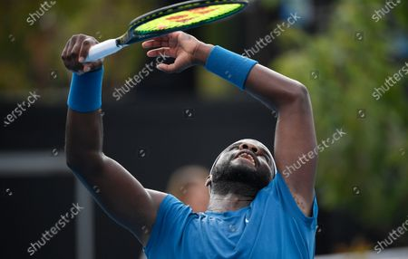 United States' Frances Tiafoe reacts during his first round match against Italy's Stefano Travaglia during their first round match at the Australian Open tennis championship in Melbourne, Australia