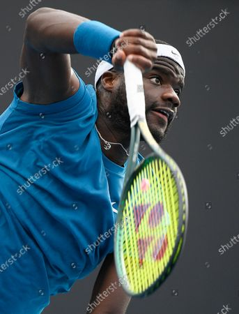 United States' Frances Tiafoe serves to Italy's Stefano Travaglia during their first round match at the Australian Open tennis championship in Melbourne, Australia