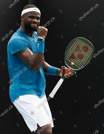 United States' Frances Tiafoe reacts after winning a point against Italy's Stefano Travaglia during their first round match at the Australian Open tennis championship in Melbourne, Australia