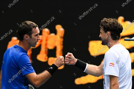Mikhail Kukushkin of Kazakhstan (L) congratulates Dominic Thiem of Austria (R) after their first Round Men's singles match on Day 1 of the Australian Open at Melbourne Park in Melbourne, Australia, 08 February 2021.