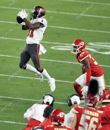 Stock Image of Tampa Bay Buccaneers' Antonio Brown grabs a catch above Kansas City Chiefs' Charvarius Ward (35) during the first half of Super Bowl LV at Raymond James Stadium