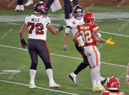 Tampa Bay Buccaneers' Josh Wells (72) looks on as Kansas City Chiefs' Tyrann Mathieu (32) yells at Tampa Bay quarterback Tom Brady (12) during the first half of Super Bowl LV at Raymond James Stadium