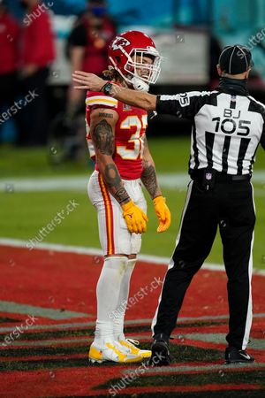 Stock Image of Kansas City Chiefs Tyrann Mathieu (32) argues with a referee during a game against the Tampa Bay Buccaneers during the NFL Super Bowl LV football game, in Tampa, Fla