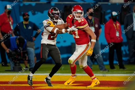 Tampa Bay Buccaneers cornerback Carlton Davis (24) defends against Kansas City Chiefs tight end Travis Kelce (87) during the second half of the NFL Super Bowl 55 football game, in Tampa, Fla. The Tampa Bay Buccaneers defeated the Kansas City Chiefs 31-9