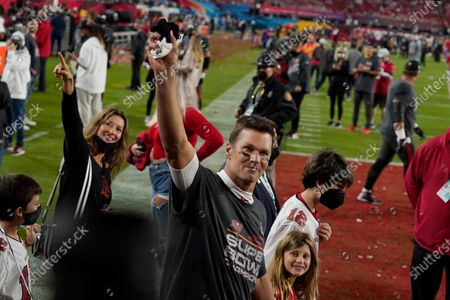 Stock Picture of Tampa Bay Buccaneers quarterback Tom Brady walks off the field with his wife, Gisele Bundchen, left, and their family after the NFL Super Bowl 55 football game against the Kansas City Chiefs, in Tampa, Fla. The Buccaneers defeated the Chiefs 31-9 to win the Super Bowl