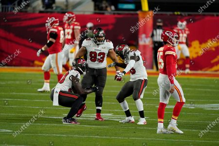 Tampa Bay Buccaneers Ndamukong Suh (93) celebrates with teammates against the Kansas City Chiefs during the NFL Super Bowl LV football game, in Tampa, Fla