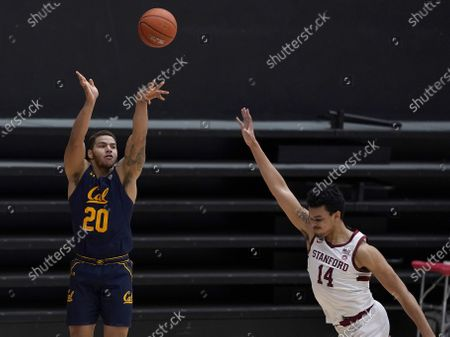 California guard Matt Bradley (20) shoots against Stanford forward Spencer Jones (14) during the first half of an NCAA college basketball game in Stanford, Calif