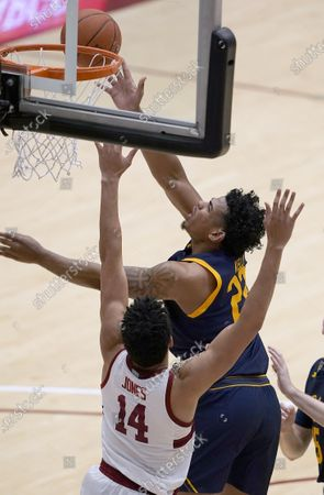 California forward Andre Kelly (22) drives to the basket against Stanford forward Spencer Jones (14) during the second half of an NCAA college basketball game in Stanford, Calif